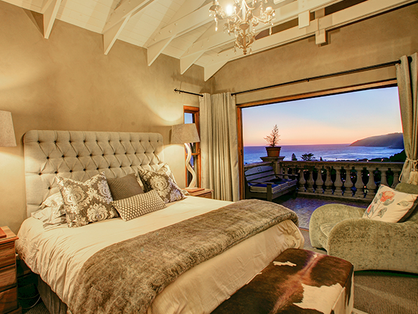 Main bedroom balcony with sunset views.
