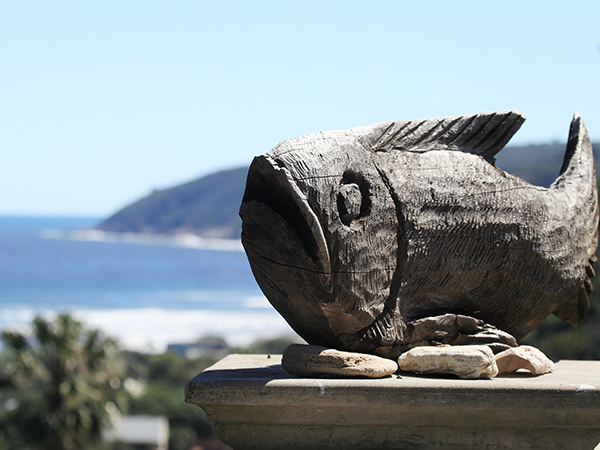 Wooden fish and seaview